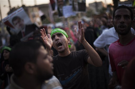 A supporter of Egypt's ousted President Mohammed Morsi chants slogans against the Egyptian army during a protest near Cairo University in Giza, Egypt, on Sunday.