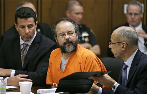 Ariel Castro listens during the sentencing phase of his trial on Thursday in Cleveland. Defense attorney's Craig Weintraub, left, and Jaye Schlachet sit beside Castro.