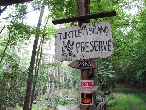 No trespassing signs are posted at the entrance to Turtle Island Preserve in Triplett, N.C., on June 27. Turtle Island lies near the Tennessee border, just a few miles east of Boone, N.C., a county seat of 17,000 residents whose population doubles when Appalachian State University, owner Eustace Conway's alma mater, is in session.