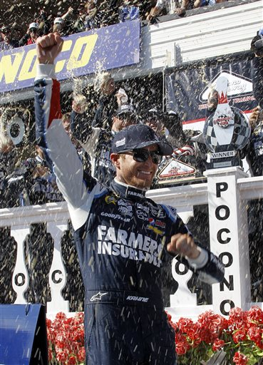 Kasey Kahne celebrates in victory lane after winning a NASCAR Sprint Cup Series auto race Sunday at Pocono Raceway in Long Pond, Pa. Jeff Gordon was second.