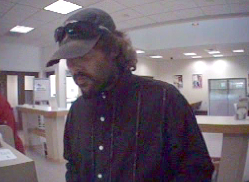 This surveillance photo shows a man who walked into the Newport Key Bank branch on Thursday afternoon and demanded money.