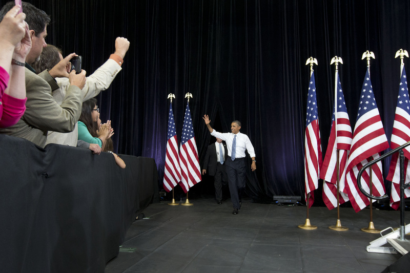 President Barack Obama waves to the crowd as he arrives to speak about housing Tuesday at Desert Vista High School in Phoenix. Afterward, the president headed to Los Angeles to appear on