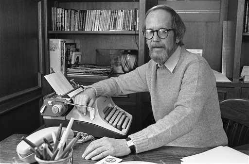 In this March 1983 photo, Elmore Leonard sits by his typewriter at his home in Michigan. Leonard wrote in longhand on unlined yellow pads that were custom-made for him, and when he finished a page he transferred the words onto a separate piece of paper using the typewriter.