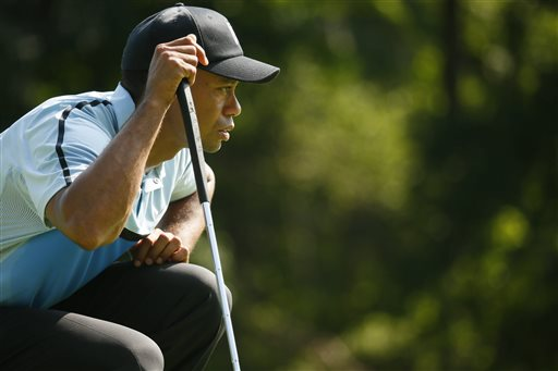 Tiger Woods lines up his putt on the 14th green during the first round of the PGA Championship golf tournament at Oak Hill Country Club, Thursday, Aug. 8, 2013, in Pittsford, N.Y. (AP Photo/The Buffalo News, Derek Gee)