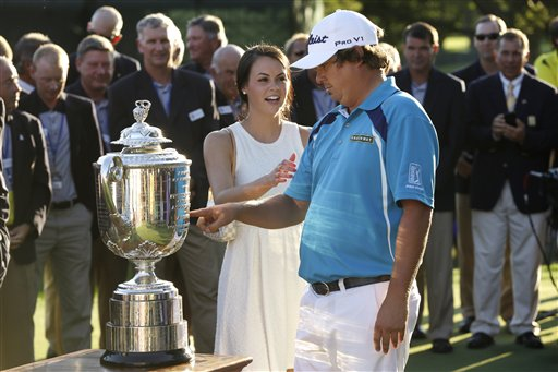 Jason Dufner looks at the Wanamaker Trophy with his wife Amanada after winning the PGA Championship on Sunday at Oak Hill Country Club in Pittsford, N.Y. Dufner shot a 2-under 68 in the round to clinch the title.