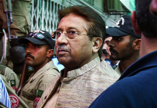 In this April 20, 2013, photo, Pakistan's former president and military ruler Pervez Musharraf arrives at an anti-terrorism court in Islamabad, Pakistan. A Pakistani court Tuesday indicted Musharraf on murder charges in connection with the 2007 assassination of iconic Pakistani Prime Minister Benazir Bhutto, deepening the fall of a once-powerful figure who returned to the country this year in an effort to take part in elections.