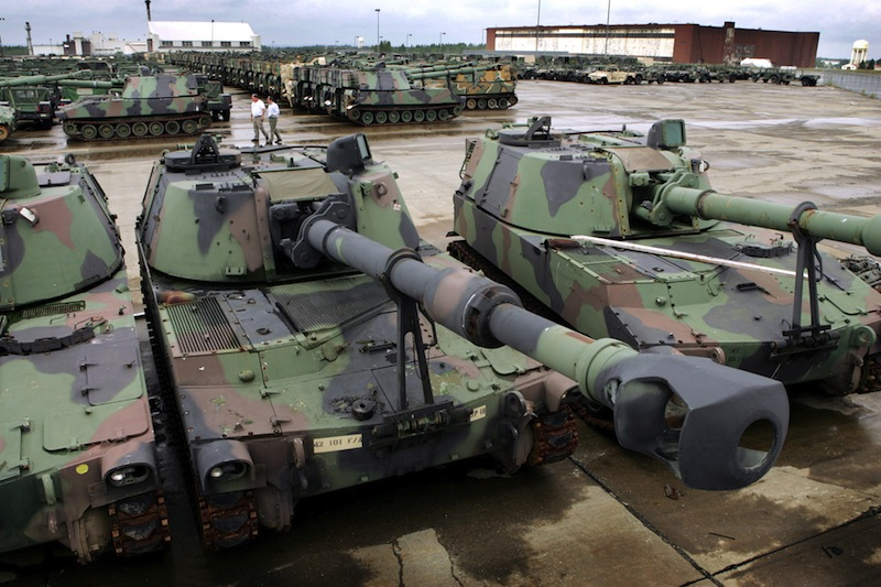 In this 2005 file photo, 380 M-109 Howitzers tanks and 800 Humvees, along with other military vehicles, await refurbishing at the Maine Military Authority in Limestone. The Maine Military Authority is laying off 140 people beginning in October because of the drawdown of troops and equipment in Iraq and Afghanistan. (AP Photo/Robert F. Bukaty)