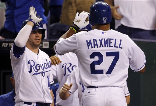 Kansas City Royals' Justin Maxwell (27) is congratulated by Brett Hayes (12) after hitting a home run in the eighth inning of a baseball game against the Boston Red Sox at Kauffman Stadium in Kansas City, Mo., Thursday, Aug. 8, 2013. (AP Photo/Colin E. Braley)