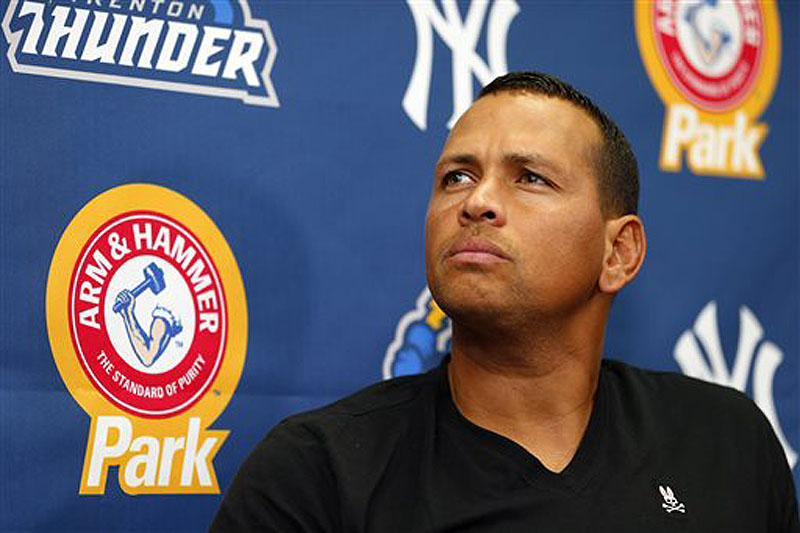 New York Yankees third baseman Alex Rodriguez answers questions during a news conference after a minor league baseball rehab start with the Trenton Thunder on Saturday. Rodriguez all but said he thought Major League Baseball and the Yankees were conspiring to keep him from getting back to the big leagues. He is expected to be suspended Monday but can play while he appeals the penalty.