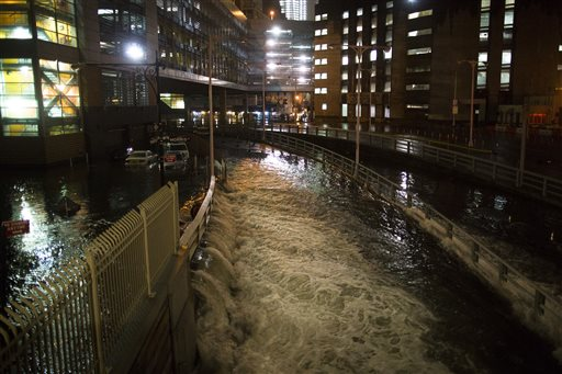 In this Monday, Oct. 29, 2012 file photo, seawater floods the entrance to New York City's Brooklyn Battery in the wake of Superstorm Sandy. A presidential task force recommends 69 measures that might help insure that coastal areas aren't as vulnerable to future storms in an age of rising sea levels.