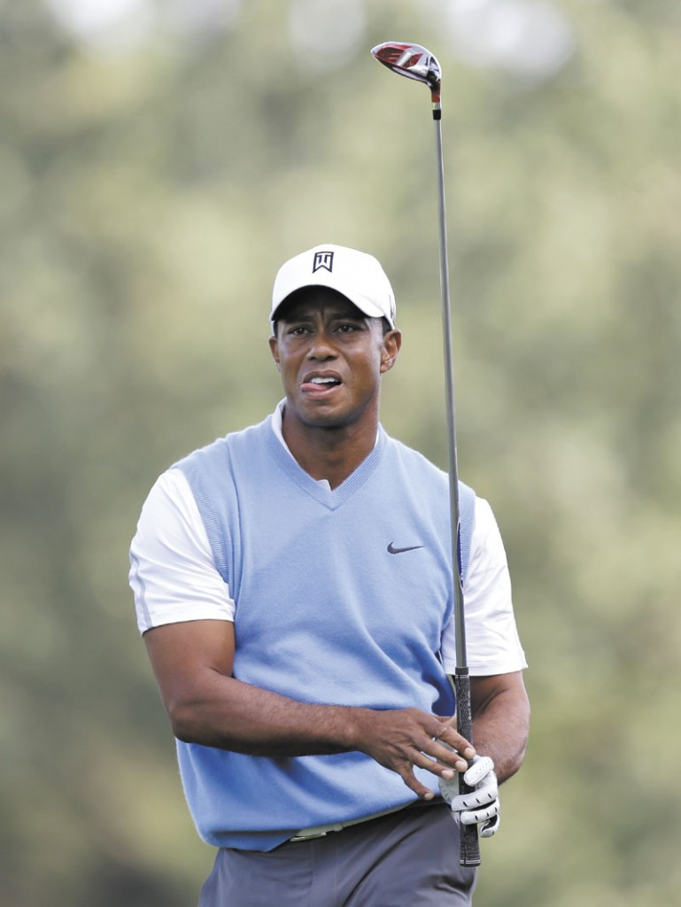 RARING TO GO: Tiger Woods watches his shot from the 16th tee during a practice round Tuesday for the PGA Championship at Oak Hill Country Club, in Pittsford, N.Y.