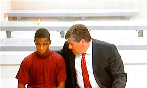Demetrius Glenn, who is charged is charged with first-degree murder and first-degree robbery in the beating death of 88-year-old World War II veteran Delbert Belton, listens to his lawyer, Christian J. Phelps, before an appearance via video teleconference in District Court in Spokane, Wash., on Monday. Glenn who will be tried as an adult.
