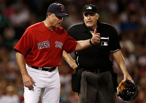 Boston Red Sox manager John Farrell argues with home plate umpire Bill Welke, who ruled that Mike Carp was not hit by a pitch during the seventh inning of a baseball game against the New York Yankees at Fenway Park in Boston Friday, Aug. 16, 2013. (AP Photo/Winslow Townson)