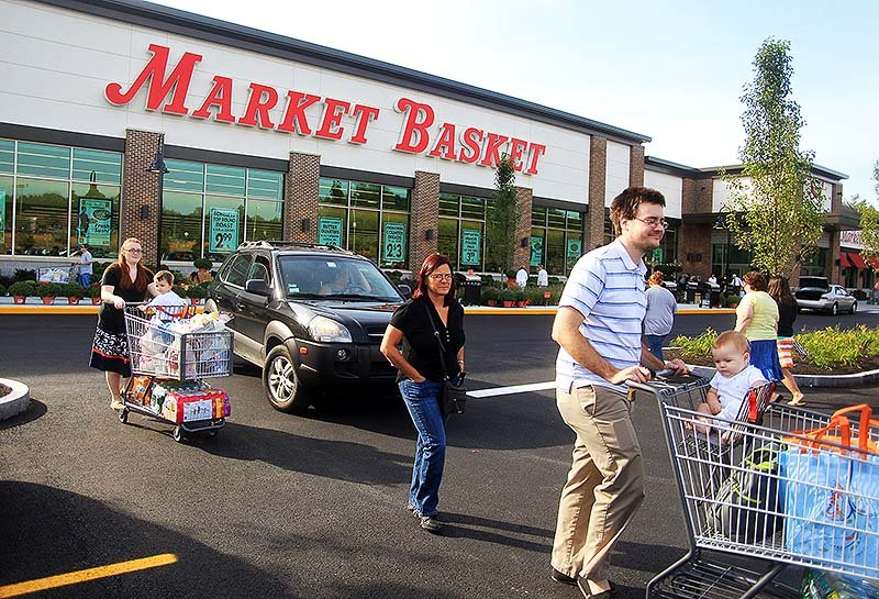 Shoppers leave Market Basket as it opens its first store in Maine, in Biddeford, on Sunday.