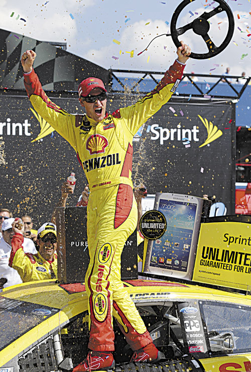 YES! Joey Logano celebrates after winning the Pure Michigan 400 race Sunday at Michigan International Speedway in Brooklyn, Mich.