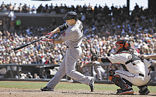 SMASHED: Boston's Stephen Drew hits a three-run home run off San Francisco Giants pitcher Michael Kickham during the seventh inning Wednesday in San Francisco. Giants catcher Buster Posey looks on.