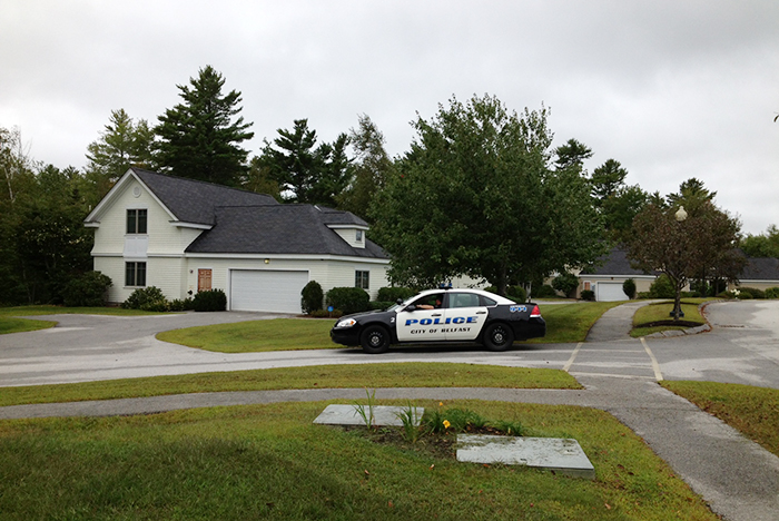 A Belfast police car sits outside the home of murder suspect Todd Gilday, at 30-A Spring Brook Drive, in Belfast Thursday morning.