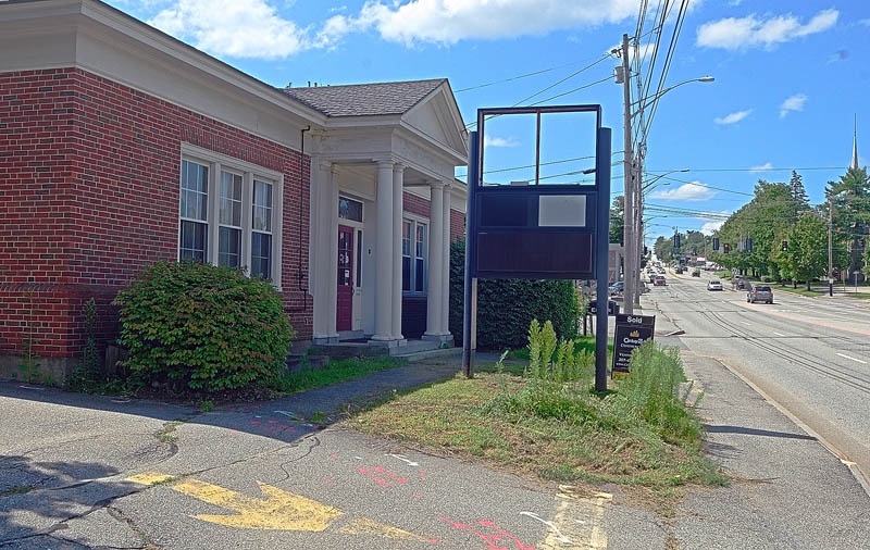This photo taken Aug. 14 shows the former bank building at 22 Western Ave. in Augusta, that is the proposed site for a Dunkin Donuts in Augusta. A drive-through location nearby, on Sewall Street, would close if the development is approved.
