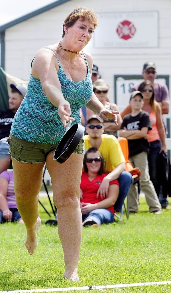 Anissa Chase, 42, of Whitefield, competes in the Ladies Fry Pan Throwing Contest today at the Windsor Fair.