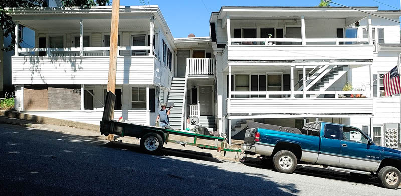 Eric Smith loads up a trailer as he helps his friend, William Throp, who had to move on short noticetoday from 9 Laurel St. in Augusta.