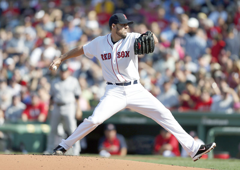 GETTING IT DONE: Boston starting pitcher John Lackey allowed one run on six hits in 62⁄3 innings as the Red Sox beat the Yankees 6-1 on Saturday at Fenway Park in Boston.