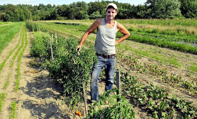 Farmer Jay Robinson stands in one of his vegetable fields in Starks. Robinson is behind an effort to create a labor pool to employ local workers at his farm.
