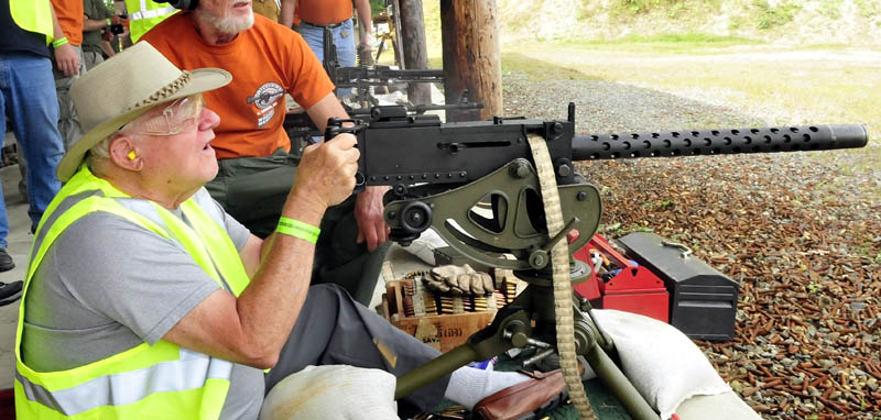 Veteran Roland Marquis, of Augusta, fires a machine gun during the Wounded Warriors Machine Gun Shoot in North Anson today.