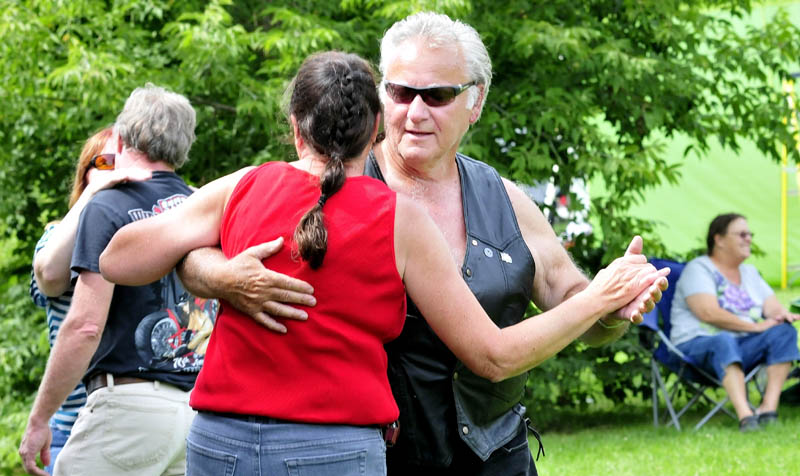 Ted Mills and Kathleen Laffin joined other dancers as the band BorderLine Express played in Fort Halifax Park in Winslow on Sunday during the A Day in the Park for the Arts fundraiser, set up to benefit Winslow High School's performing arts programs.
