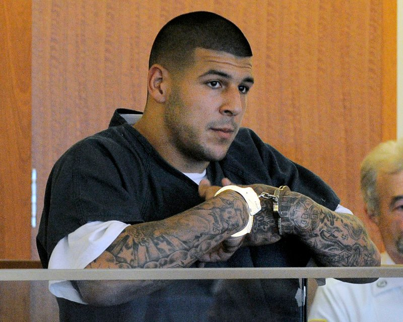 Former New England Patriots tight end Aaron Hernandez stands during a bail hearing in Fall River Superior Court in Fall River, Mass., on June 27.