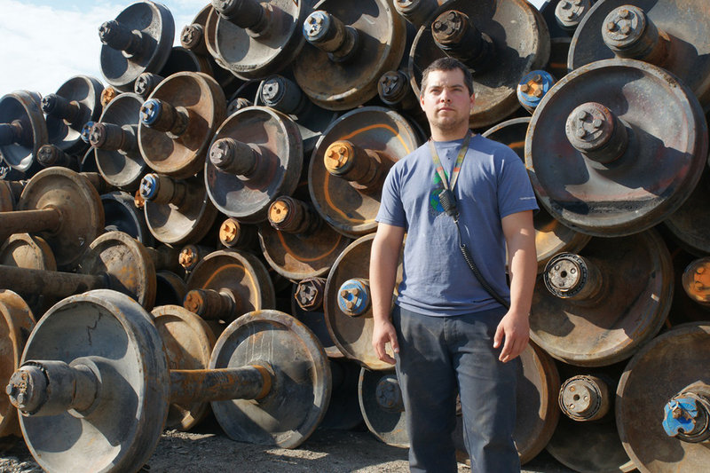 Francis Cliche, 28, a scrap dealer in the town of Frontenac, stands in front of wheels taken from tanker cars that were wrecked in the July 6 accident in Lac-Megantic. Cliche said his children's baby sitter was killed in the disaster.