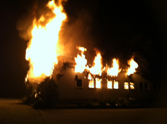 Wescustogo Hall in North Yarmouth is engulfed in flames early Friday morning.