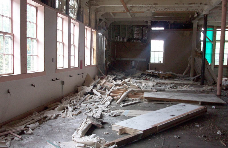 Asbestos-laden debris is seen inside the former Forster Mill in Wilton in 2011.