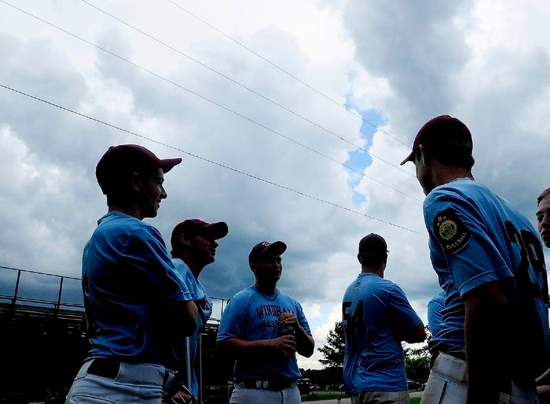 NO FUN: Players on the Windham American Legion baseball team wait in the parking lot watching storm clouds roll in on Sunday at Morton Field in Augusta. They had beaten Bangor 5-4 earlier in the day. But then the state championship game against Westbrook was postponed until 2 p.m. today because of the weather.