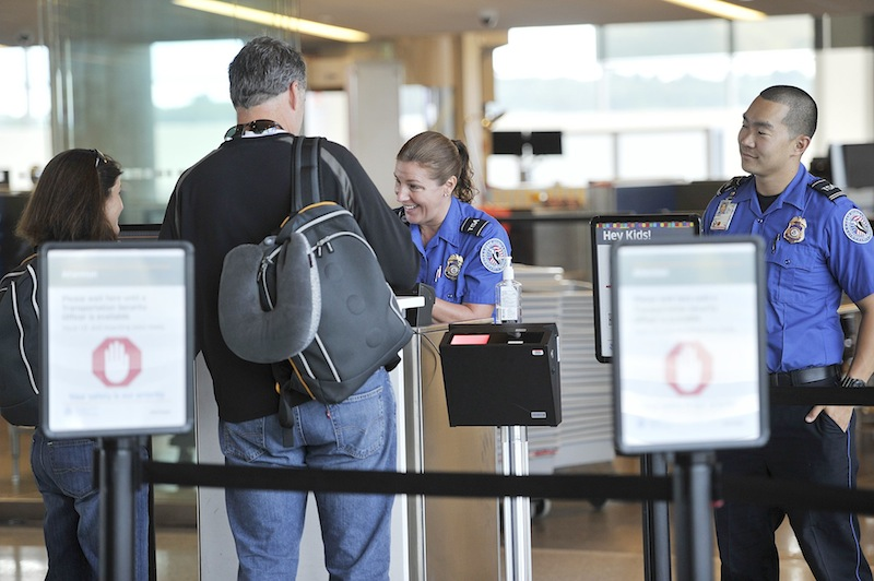 The TSA is implementing fast-track service for air passengers at a number of airports around the country, including the Portland International Jetport. TSA agents Donna Castle and Trevor Costin conduct document checks for travelers at the Jetport on Thursday.