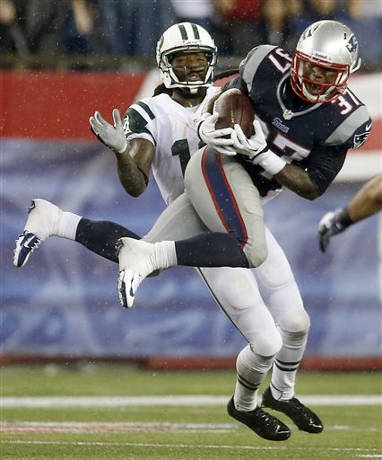 New England Patriots cornerback Alfonzo Dennard (37) intercepts a pass intended for New York Jets wide receiver Clyde Gates, rear, during the fourth quarter of an NFL football game Thursday, Sept. 12, 2013, in Foxborough, Mass. (AP Photo/Elise Amendola) NFLACTION13;