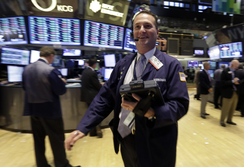 Trader Jonathan Corpina works on the floor of the New York Stock Exchange on Wednesday. The stock market hit a record high Wednesday after the Federal Reserve's surprise decision to keep its economic stimulus in place.