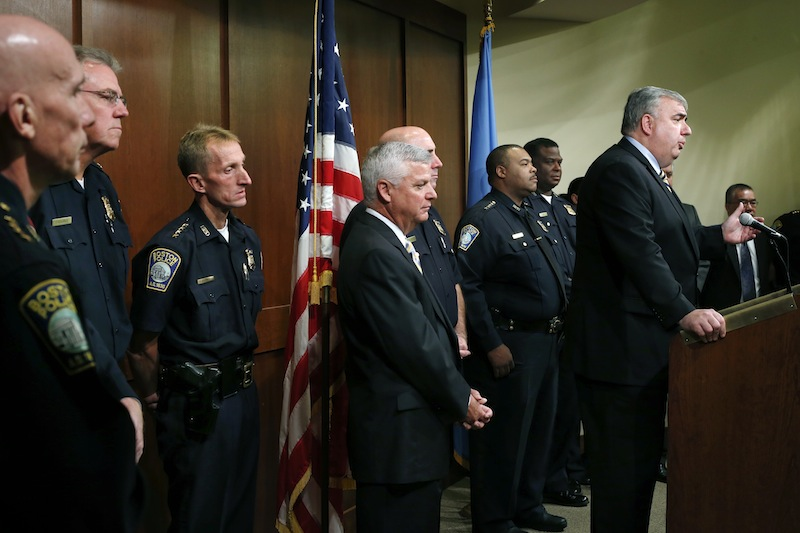 Boston Police Commissioner Edward Davis speaks during a news conference in Boston, Monday Sept. 23, 2013, as he announces that he is stepping down after seven years on the job. The 57-year-old Davis was appointed Boston's top cop by Mayor Thomas Menino in 2006. He previously served as the Lowell, Mass., police superintendent. (AP Photo/Elise Amendola)