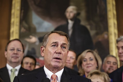Speaker of the House John Boehner, R-Ohio, and Republican members of the House of Representatives rally at the Capitol on Friday after passing a bill that would prevent a government shutdown while crippling the Affordable Care Act.