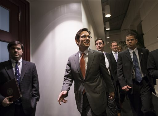 House Majority Leader Eric Cantor, R-Va., arrives for a closed-door meeting with fellow Republicans as the House of Representatives worked into the night to pass a bill to fund the government, at the Capitol in Washington on Saturday.