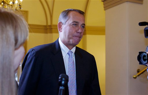 House Speaker John Boehner, R-Ohio, arrives at the U.S. Capitol in Washington today. Heat is building on balkanized Republicans, who are convening the House this weekend in hopes of preventing a government shutdown but remain under tea party pressure to battle on and use a must-do funding bill to derail all or part of President Barack Obama's health care law.