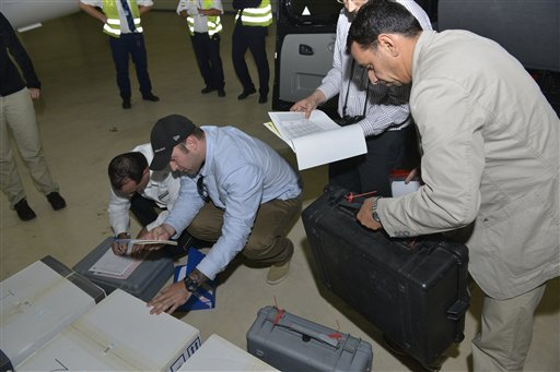 Samples brought back by a United Nations chemical weapons inspection team are checked in upon their arrival at The Hague, Netherlands, in this file photo released Aug. 31 by the Organization for the Prohibition of Chemical Weapons. Syria has sent the Organization for the Prohibition of Chemical Weapons an