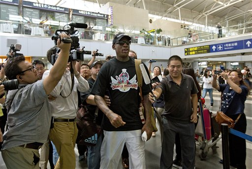 Journalists surround basketball star Dennis Rodman at the departure hall of Beijing Capital International Airport on Tuesday. Rodman is heading to North Korea for the second time this year for what he says is a friendly visit to his friend, the communist nation's leader, Kim Jong Un.