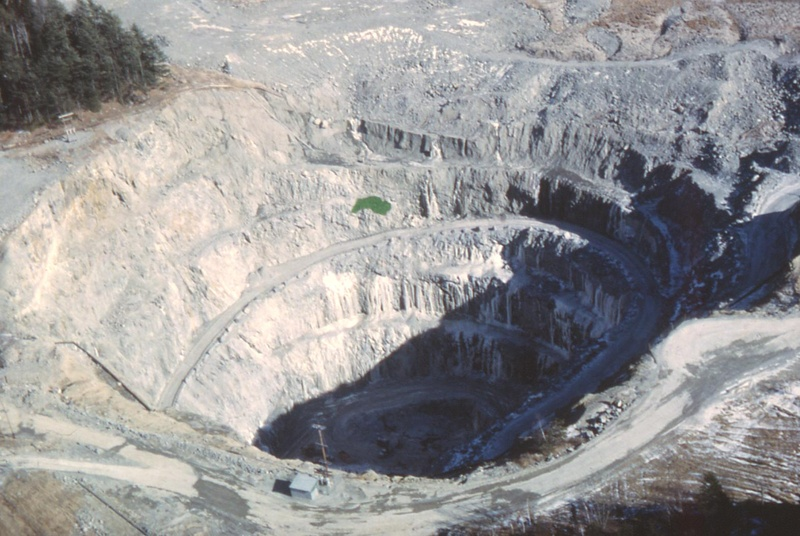 In this photo made in the 1970s, the Callahan Mining Corp. open pit in Brooksville is seen while it was still active. Maine's most recent metal ore mine, now a federal Superfund site, has led to elevated levels of toxic heavy metals the surrounding coastal estuary, according to a new study.