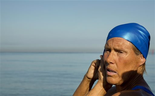 U.S. swimmer Diana Nyad, 64, adjusts her swimming cap before her swim to Florida from Havana, Cuba, Saturday, Aug. 31, 2013. Endurance athlete Nyad launched another bid Saturday to set an open-water record by swimming from Havana to the Florida Keys without a protective shark cage.