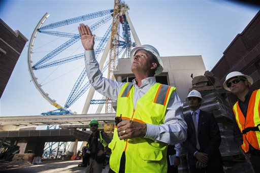 What will be the world's tallest observation wheel, know as the High Roller, is seen behind David Codiga, executive project director at The Linq construction site on Las Vegas Boulevard. The outer wheel of the 55-story High Roller ride is scheduled to be hoisted into place Monday.