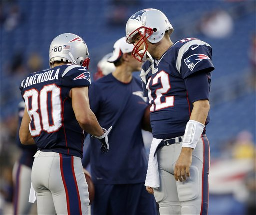 HEY, I'M TOM: New England Patriots quarterback Tom Brady, right, spent the preseason geting used to throwing to a number of new receivers, including Danny Amendola, left. Brady lost many of his favorite targets in the offseason, including Wes Welker, who signed with the Denver Broncos.