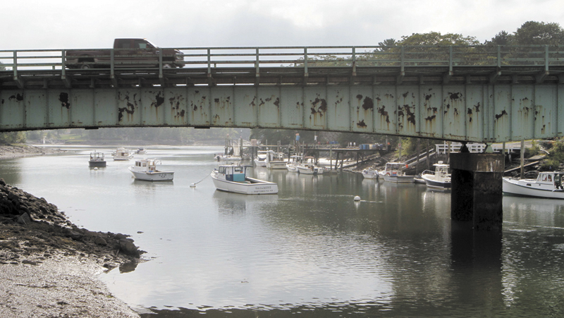 A pickup truck drives on a bridge over Sagamore Creek in Portsmouth, N.H. on Sept. 4. According to federal records from 2012, the bridge is one of several in New Hampshire that are considered both