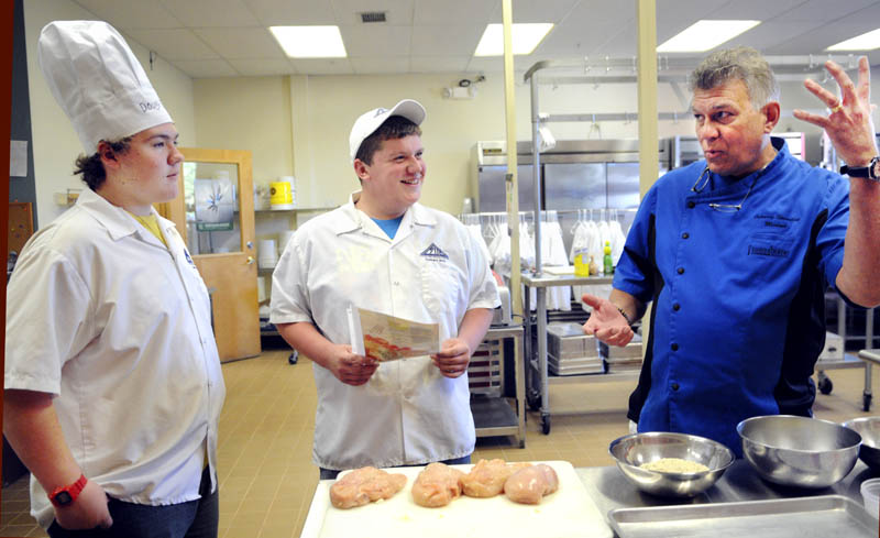 Chef Michael Barna, right, teaches Capital Area Technical Center culinary students Josh Pare, center, Travis Selwood how to bread a chicken breast Thursday at the Augusta school. Barna will appear at the The Taste of Home Cooking School in Augusta on Saturday.