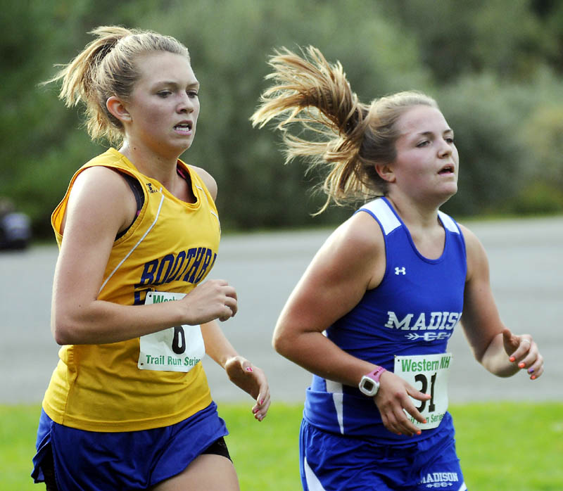 SHOULDER TO SHOULDER: Madison High School's Olivia Demchak, right, pulls ahead of Boothbay High School's Hannah Morley during a cross country meet Wednesday at the University of Maine at Augusta.
