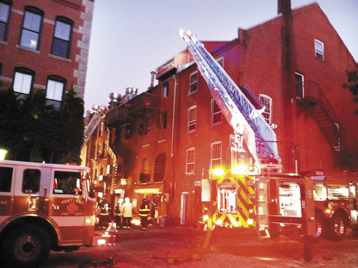 Firefighters work to put out a fire in the 400 block of Fore Street in Portland.
